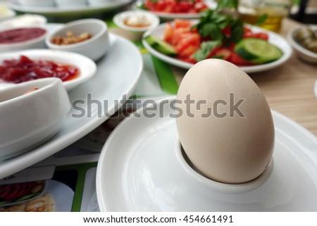 Boiled Egg on Breakfast Table - stock photo
