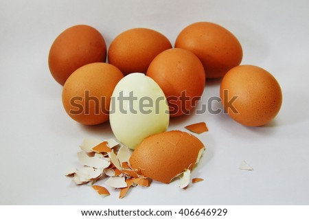 boiled egg peel shell out on white background - stock photo