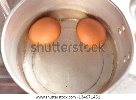 Boiled eggs in a skillet - stock photo