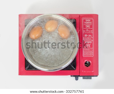 Boiled eggs on the stove - stock photo