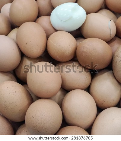 Boiled eggs pile in the tray of supermarket. - stock photo