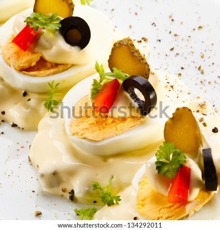 Boiled eggs with mayonnaise and vegetables