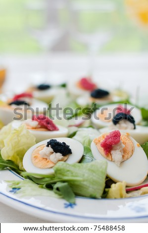 Boiled eggs with red and black caviar