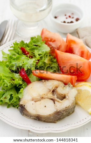 boiled fish with salad