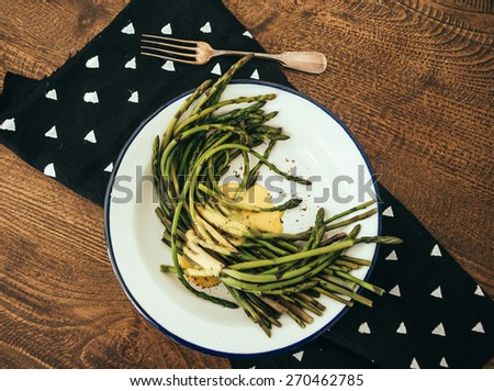 Boiled green asparagus dressed in mustard vinegar and olive oil dressing mayonnaise or hollandaise sauce - stock photo