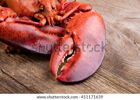 Boiled lobster on wooden background - stock photo