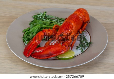 Boiled lobster served with thyme and rosemary