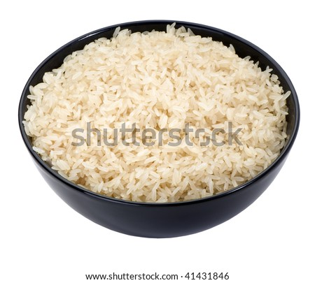 boiled long grain rice in black bowl close-up  isolated on white background  - stock photo