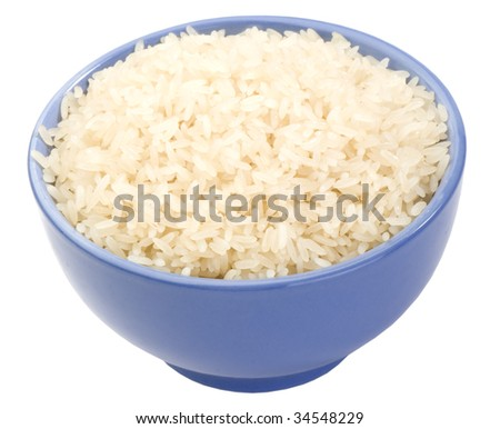 boiled long grain rice in lilac bowl close-up isolated on white background  - stock photo