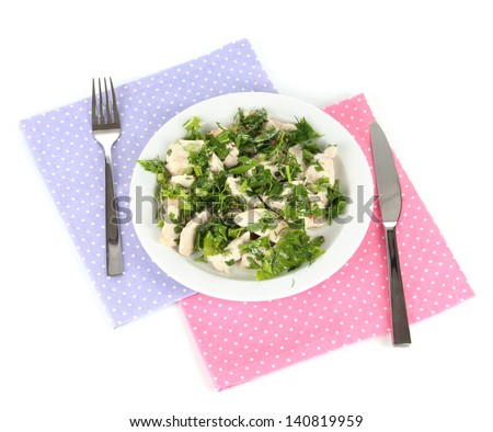 Boiled meat on plate on napkin isolated on white - stock photo