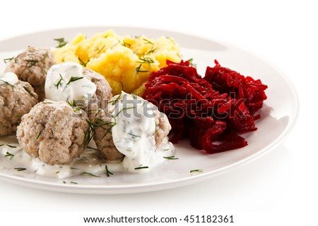Boiled meatballs, mashed potatoes and vegetables - stock photo