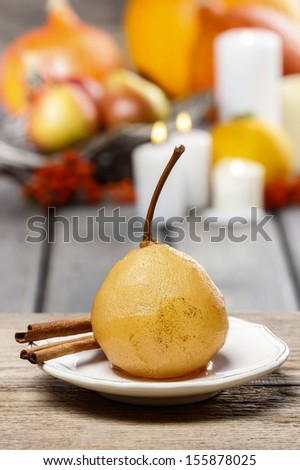 Boiled pear with cinnamon. French dessert - stock photo