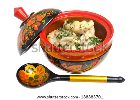 Boiled pelmeni in khokhloma painted russian wooden dish with spoon isolated on white - stock photo