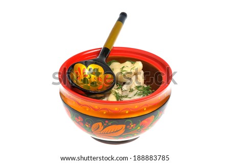Boiled pelmeni in khokhloma painted russian wooden utensils with spoon isolated on white - stock photo