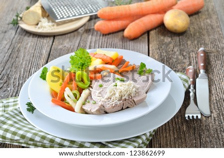 Boiled pork with mixed root vegetables and fresh horseradish - a typical Austrian dish, so-called 'Steirer Wurzelfleisch' - stock photo
