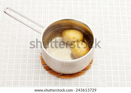 Boiled potatoes in a saucepan - stock photo