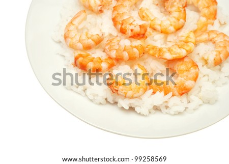 Boiled rice with royal shrimps - stock photo