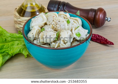 Boiled russian dumplings with meat green onion - stock photo