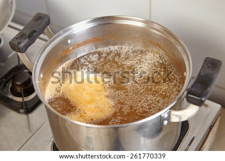 "Boiled shrimp stock prepare for base soup of traditional Indonesian cooking ""lontong mie"" - stock photo"