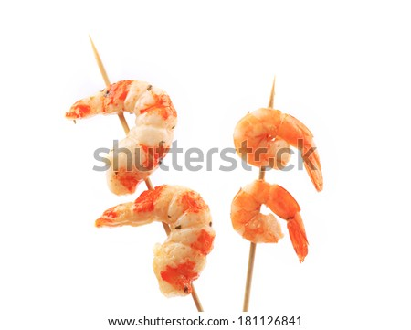Boiled shrimps on skewers. Isolated on a white background. - stock photo