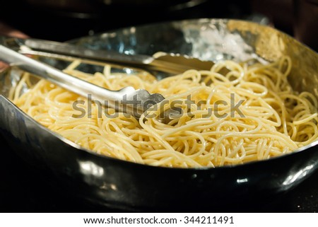 Boiled Spaghetti in Metal Bowl Preparing for the next step - stock photo