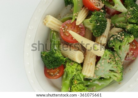 boiled young corn and broccoli served with freshness cherry tomato mixed in sesame dressing