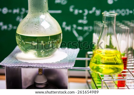 Boiling chemical liquid in Round bottom flask with alcohol lamp