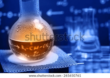 Boiling chemical liquid in Round bottom flask with alcohol lamp  - stock photo