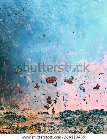 Boiling lava and volcanic bombs in a breakthrough on the slopes of the crater of the volcano cone Tolbachik - Kamchatka, Russian Federation - stock photo