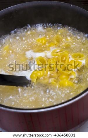 boiling macaroni - stock photo