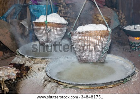 Boiling rock salt from underground water in Nan Province,Thailand - stock photo