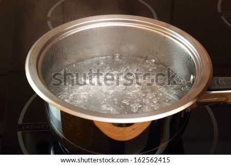 Boiling water. Candied Lemon Zest Cooking. Series. - stock photo
