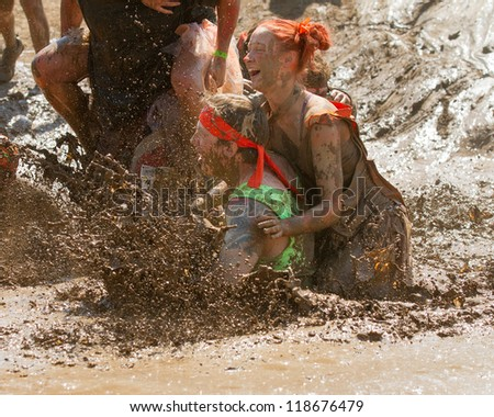 BOISE, IDAHO - AUGUST 25: People splash and make a mess at the Dirty Dash August 25 2012 in Boise, Idaho - stock photo