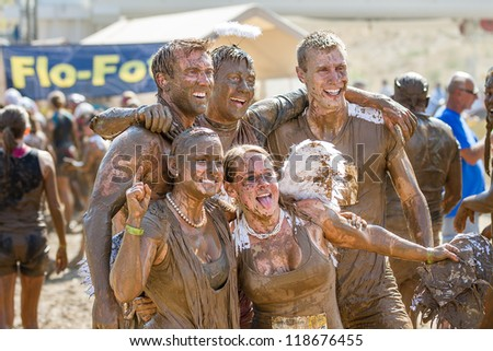 BOISE, IDAHO - AUGUST 25: Runners stop and pose for a picture at the Dirty Dash August 25 2012 in Boise, Idaho - stock photo