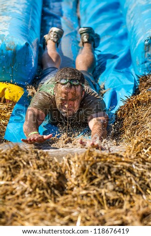 BOISE, IDAHO - AUGUST 25: Unidentified man at the bottom of the slide at the Dirty Dash August 25 2012 in Boise, Idaho - stock photo