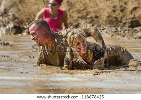 BOISE, IDAHO - AUGUST 25: Unidentified people play in the mud at the Dirty Dash August 25 2012 in Boise, Idaho - stock photo