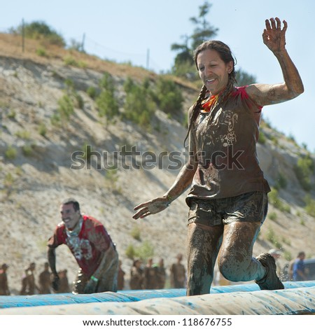 BOISE, IDAHO - AUGUST 25: Unidentified woman runs at the Dirty Dash August 25 2012 in Boise, Idaho - stock photo