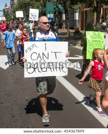BOISE, IDAHO-JULY 16 2016: Man holding the sign with the last words of Eric Garner during a boise BLM Rally