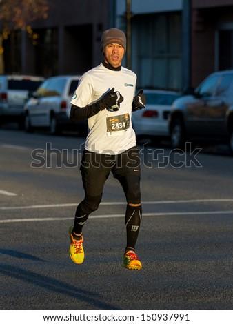 BOISE, IDAHO - NOVEMBER 22: Runner 2834 competes in the Turkey Day 5k in Boise, Idaho on November 22, 2012 - stock photo