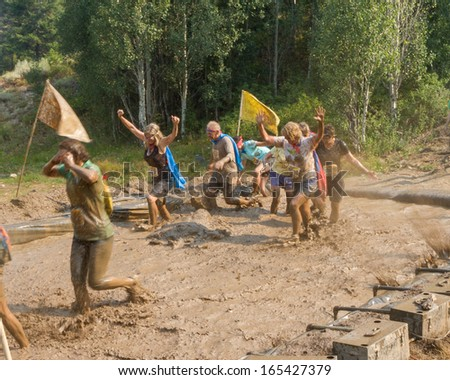 BOISE, IDAHO/USA - AUGUST 10: Group of runners racing through the mud mines at the The Dirty Dash in Boise, Idaho on August 10, 2013 - stock photo