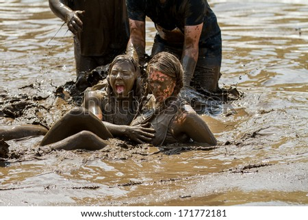 BOISE, IDAHO/USA - AUGUST 11, 2013: Two unidentified woman after falling into the mud at the dirty dash - stock photo