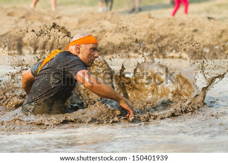 BOISE, IDAHO/USA - AUGUST 10: Unidentified participant runs while making a splash at the The Dirty Dash in Boise, Idaho on August 10, 2013  - stock photo