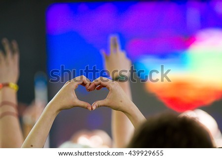BOISE, IDAHO/USA - JUNE 20, 2016: Person holding up their hands in the shape of a heart during the Queen Sessi performance at Boise Pridefest - stock photo