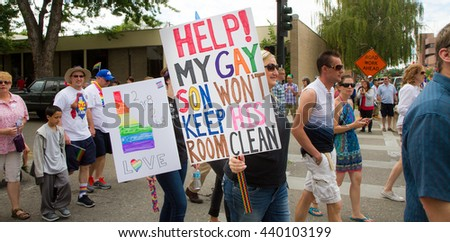 BOISE, IDAHO/USA - JUNE 20, 2016: Signs being held during the boise Pride Festival Parade