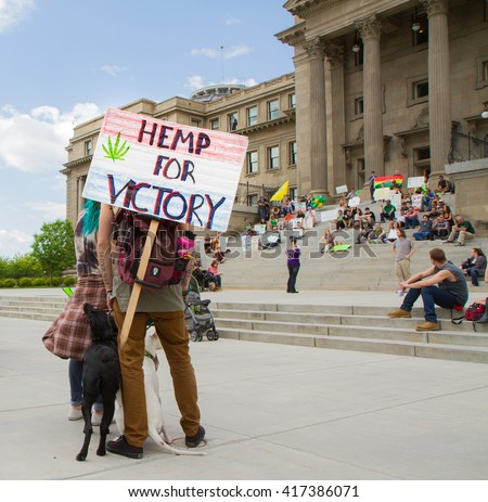 BOISE, IDAHO/USA - MAY 7, 2016: Man listening to the public speakers during the Boise, Idaho march for making pot legal - stock photo