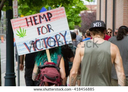 BOISE, IDAHO/USA - MAY 7, 2016: Woman walking to the Boise Capital during the Global Marijuana March in Boise