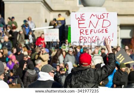 BOISE, IDAHO/USA - NOVEMBER 21, 2015: Guy telling the crowd we need to stop progrems to help refugees in Boise, Idaho - stock photo