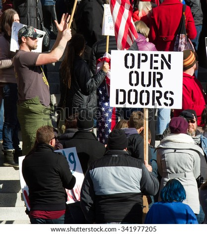 BOISE, IDAHO/USA - NOVEMBER 21, 2015: Protester in support of accepting Refugees in Boise, Idaho - stock photo