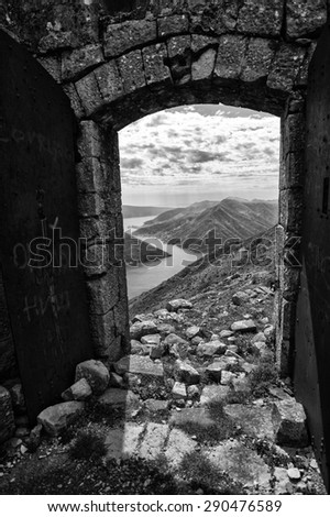 Boka bay, Montenegro in black an white trough the fortress door