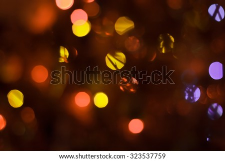 Bokeh. Abstract New Year Christmas light background in warm colors - stock photo